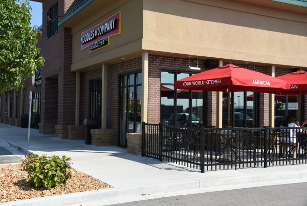 Our Commercial fencing and gates secure Noodles & Company's outdoor seating space