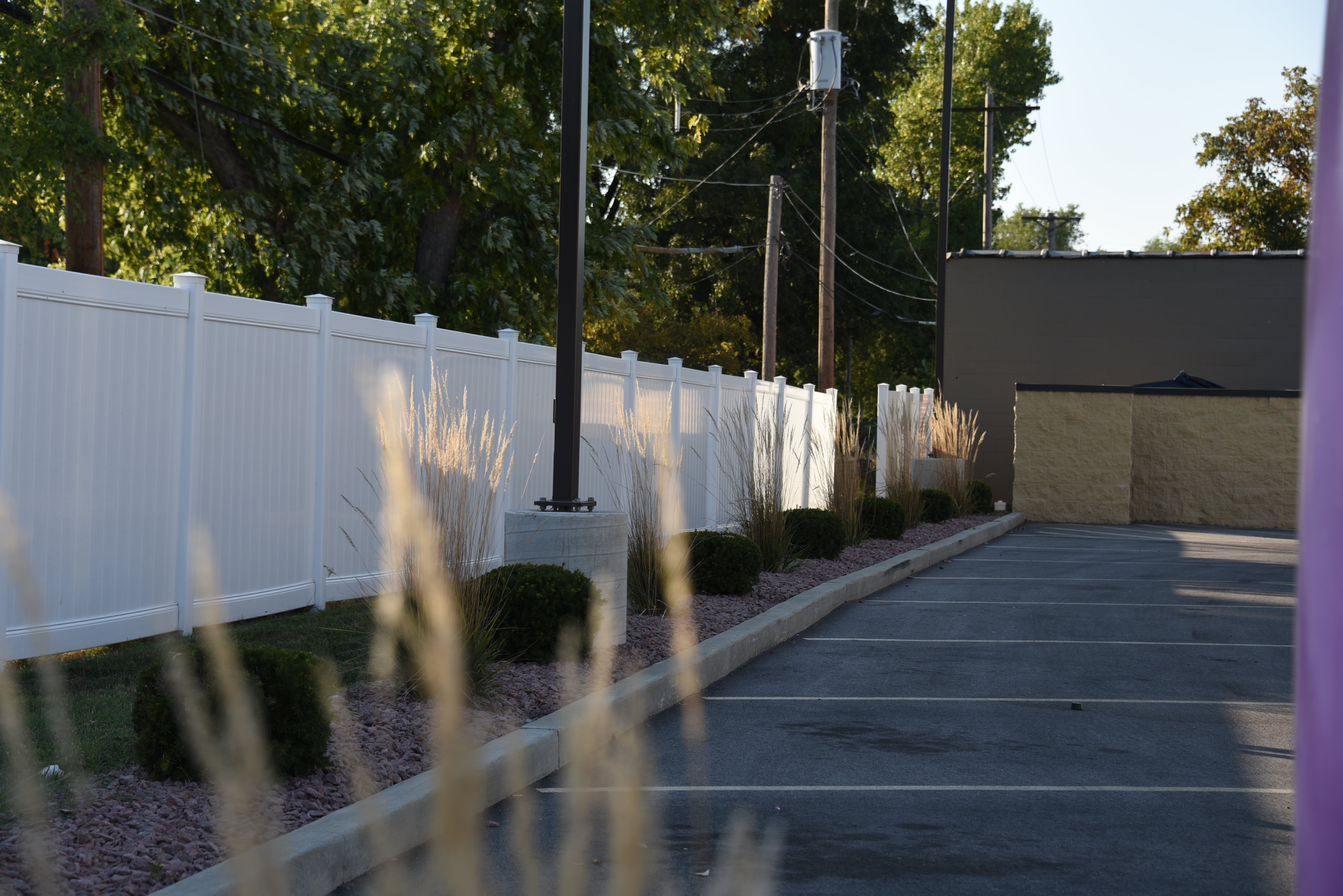 A vinyl fence that Maintenance-Free Outdoor Solutions installed at a Taco Bell in the St. Louis area