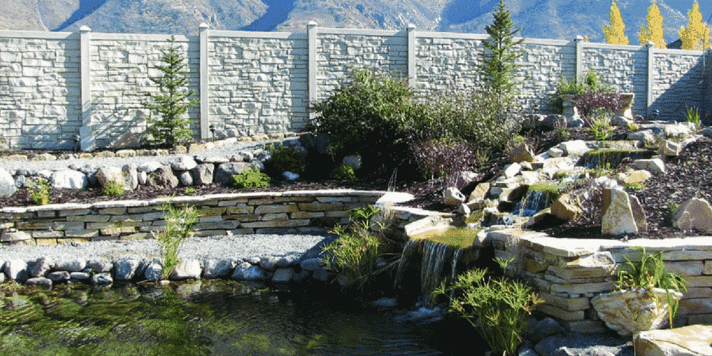 Backyard simulated stone fence surrounding a pool