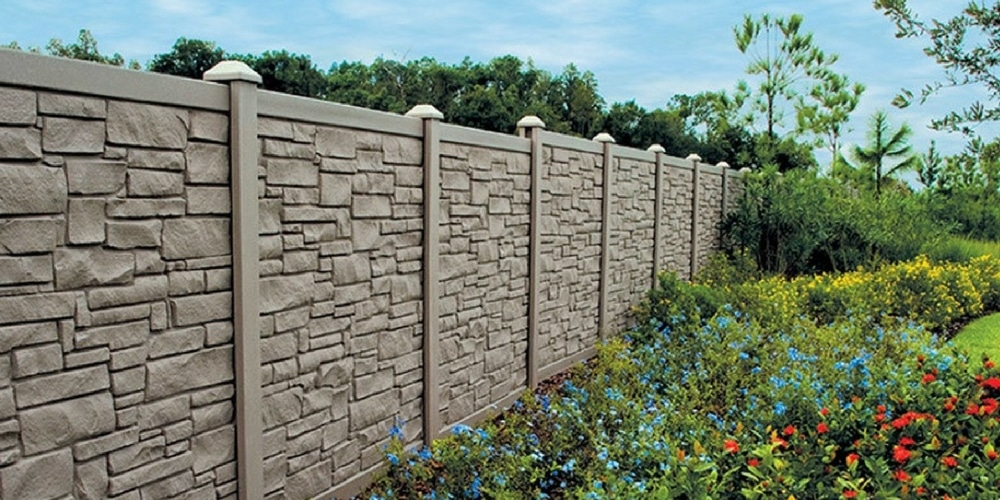 Trendy Faux stone fences in a backyard setting