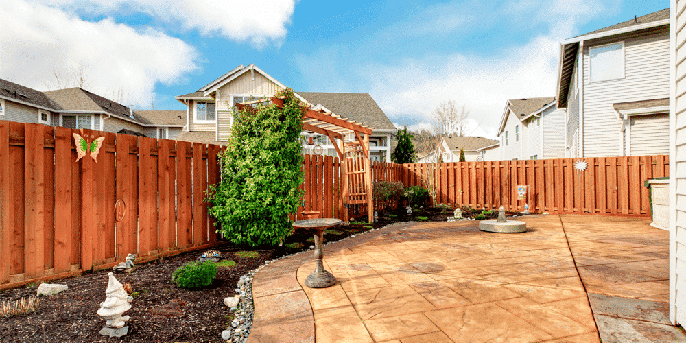backyard with brown vinyl fence